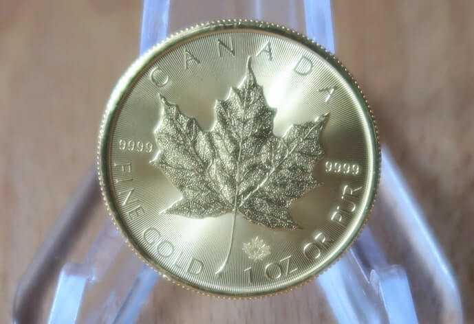 A 2020 gold maple leaf coin from the Royal Canadian Mint.